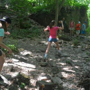 icd-volunteer-jumping-rocks
